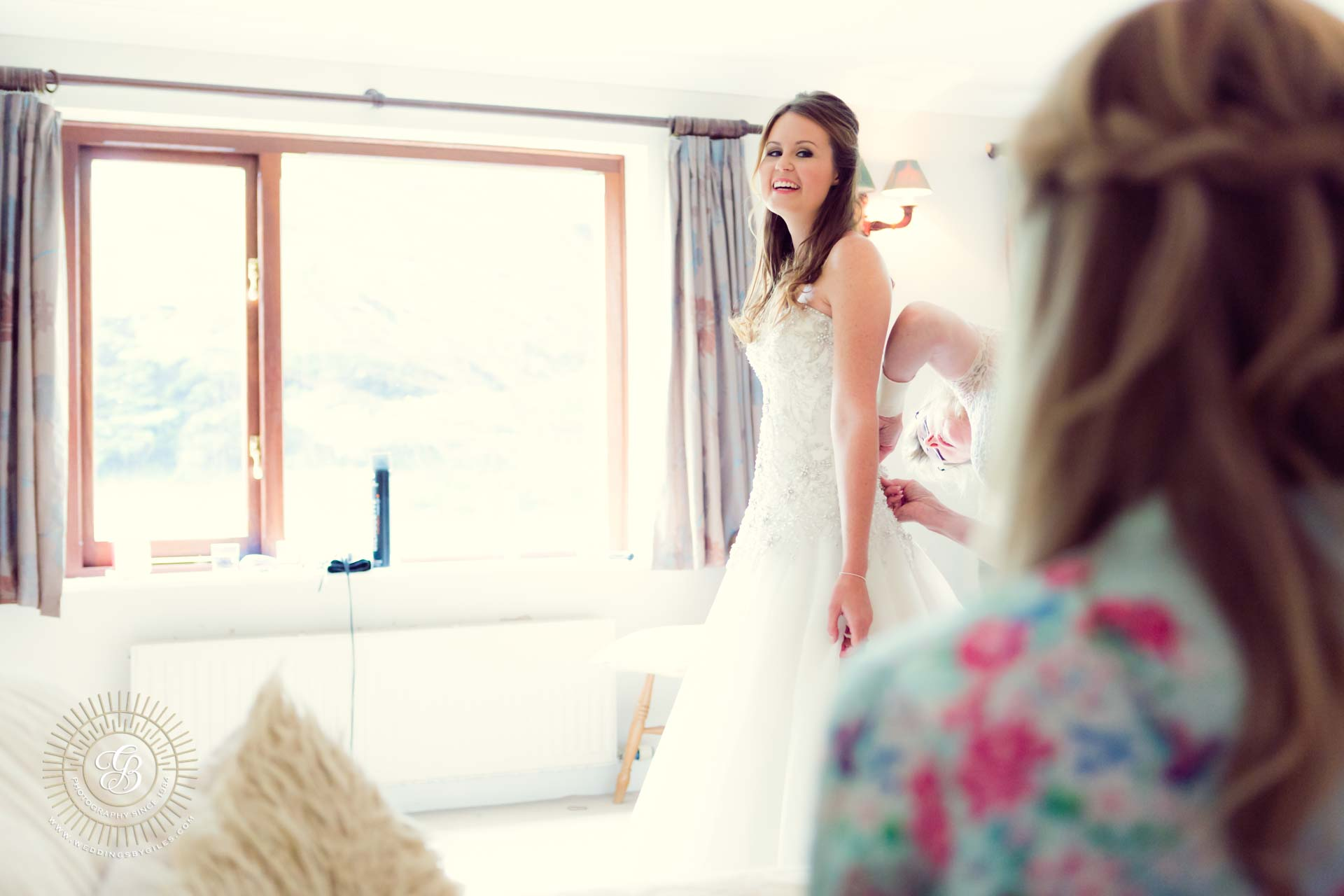 Bride getting ready with her sister