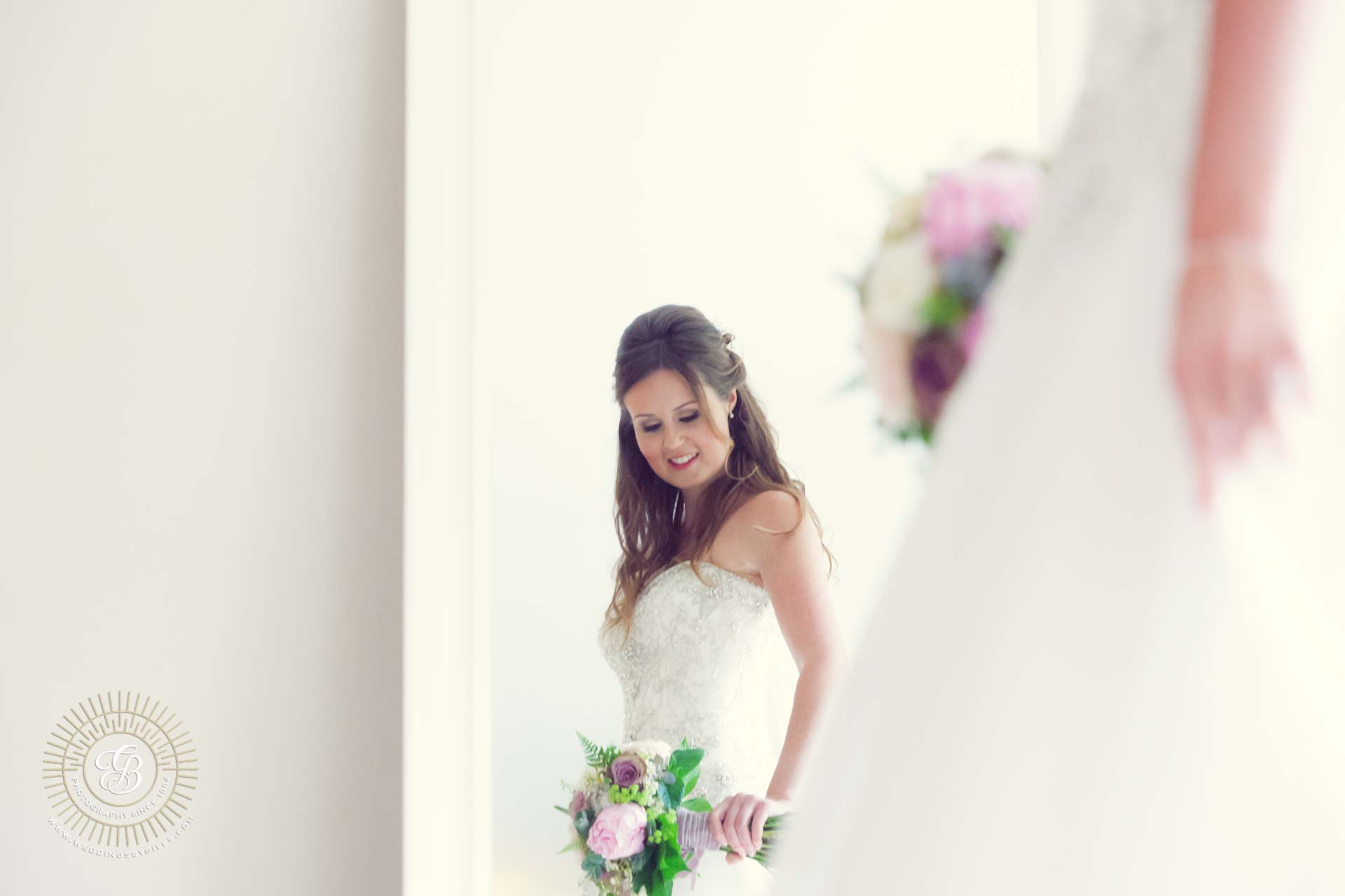 Bride looks as her bouquet