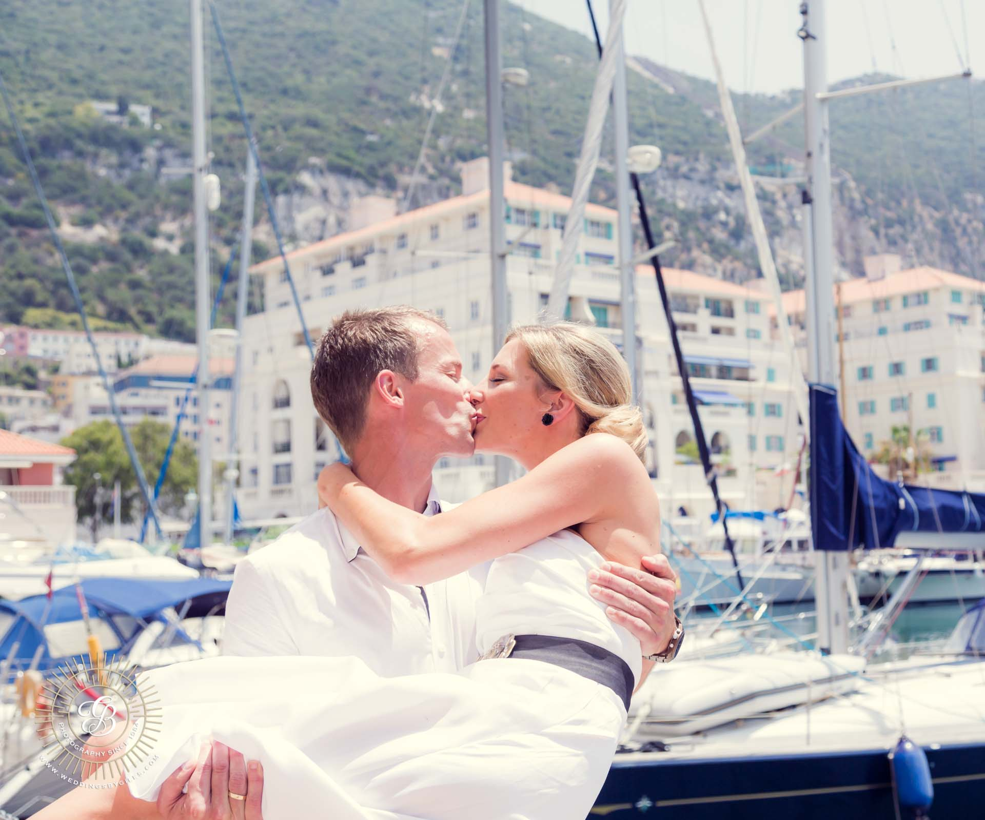 bride and groom kiss at Queensway Quay Marina