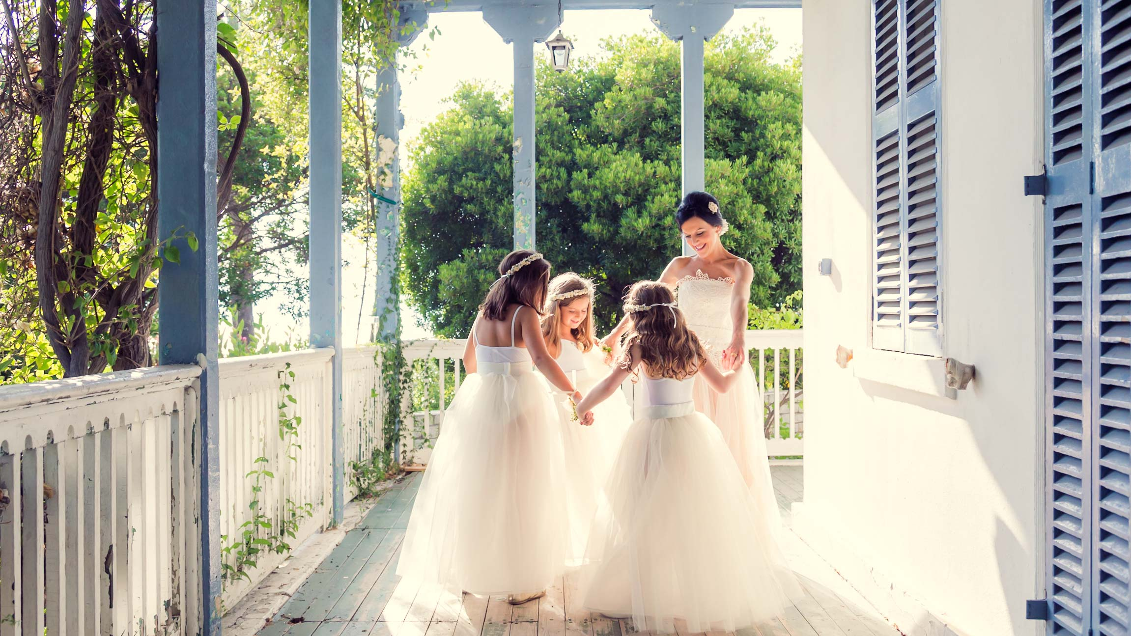 Bride and Bridesmaides on veranda