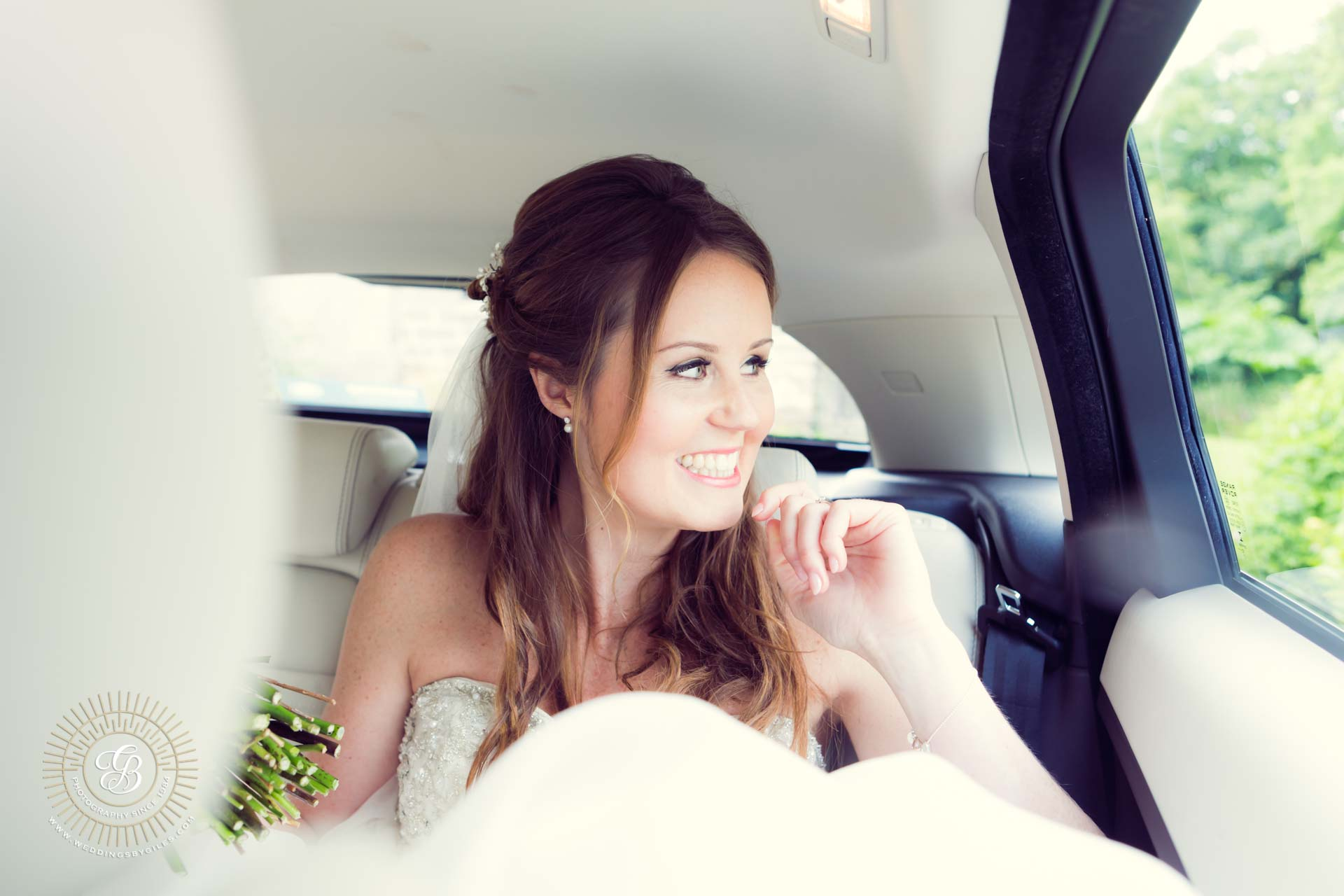 Blushing bride in her wedding car