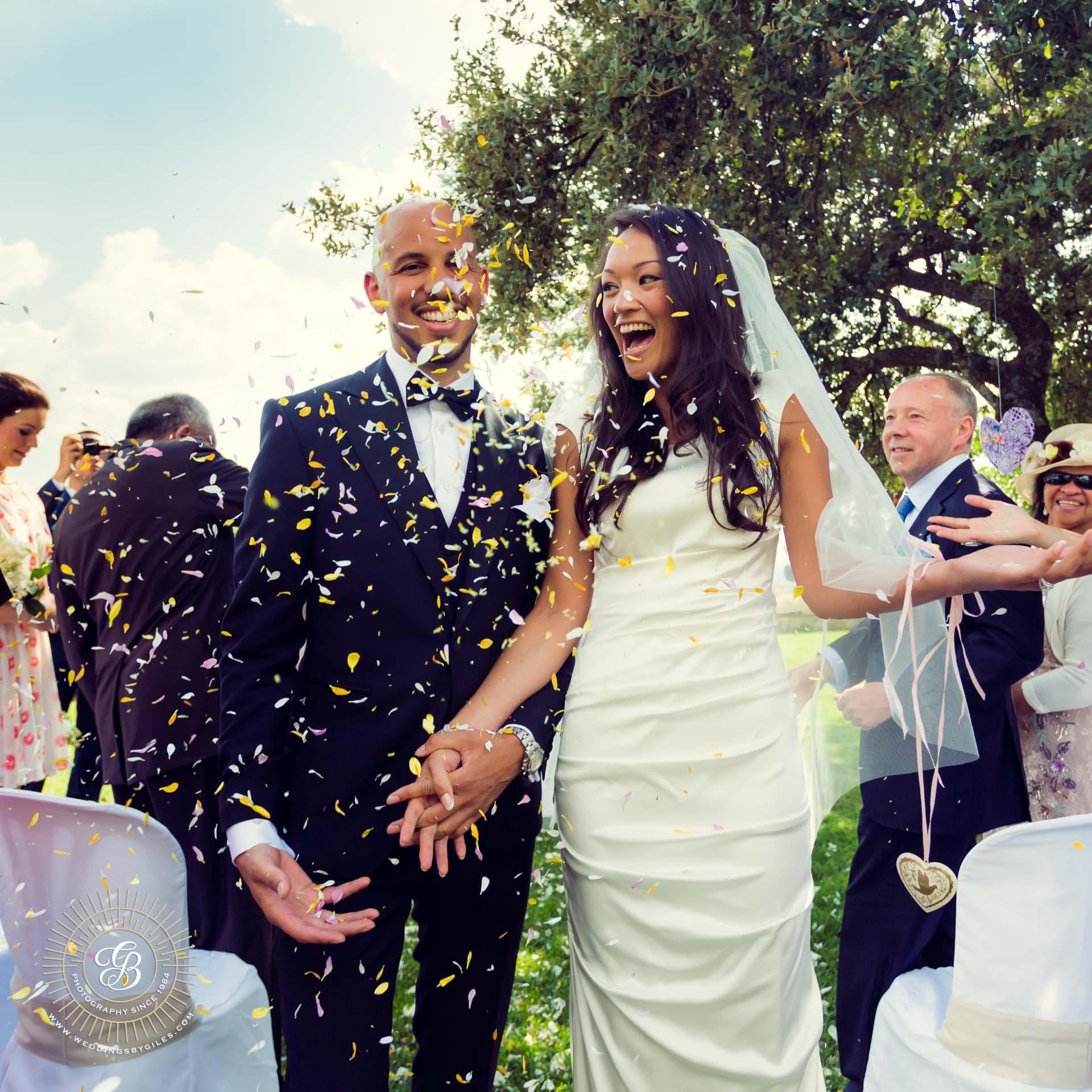 garden wedding confetti down the isle