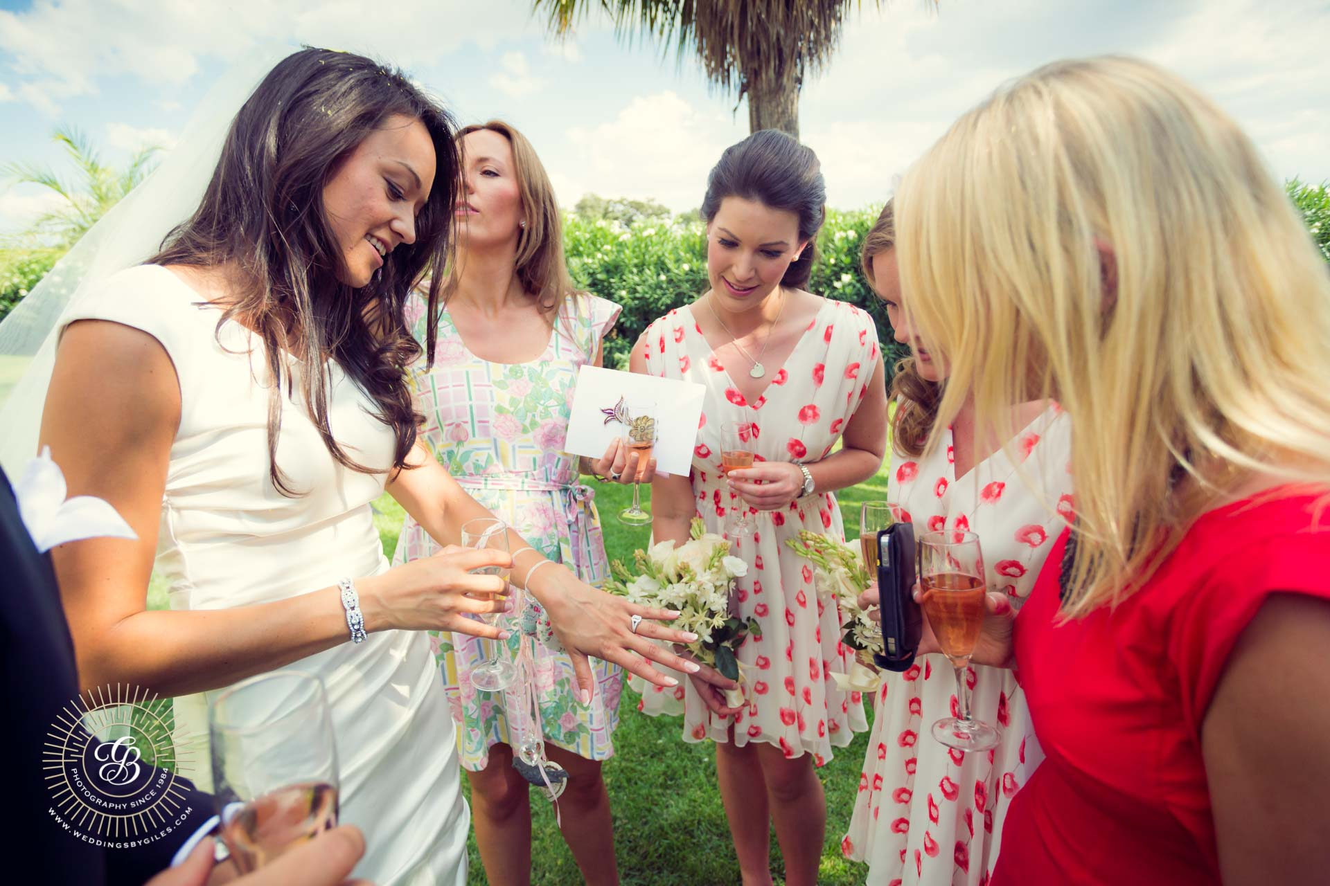 Bride shows off her ring to girl friends