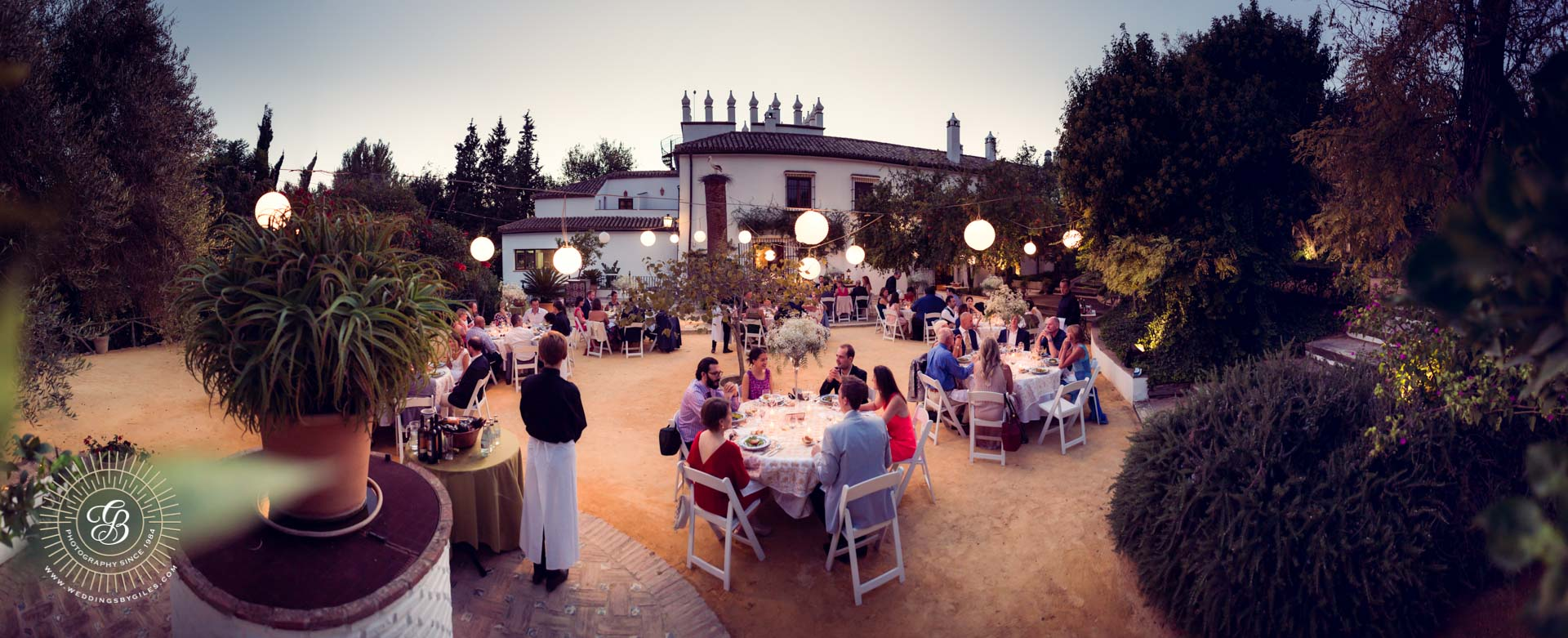 open air dinning at wedding at dusk