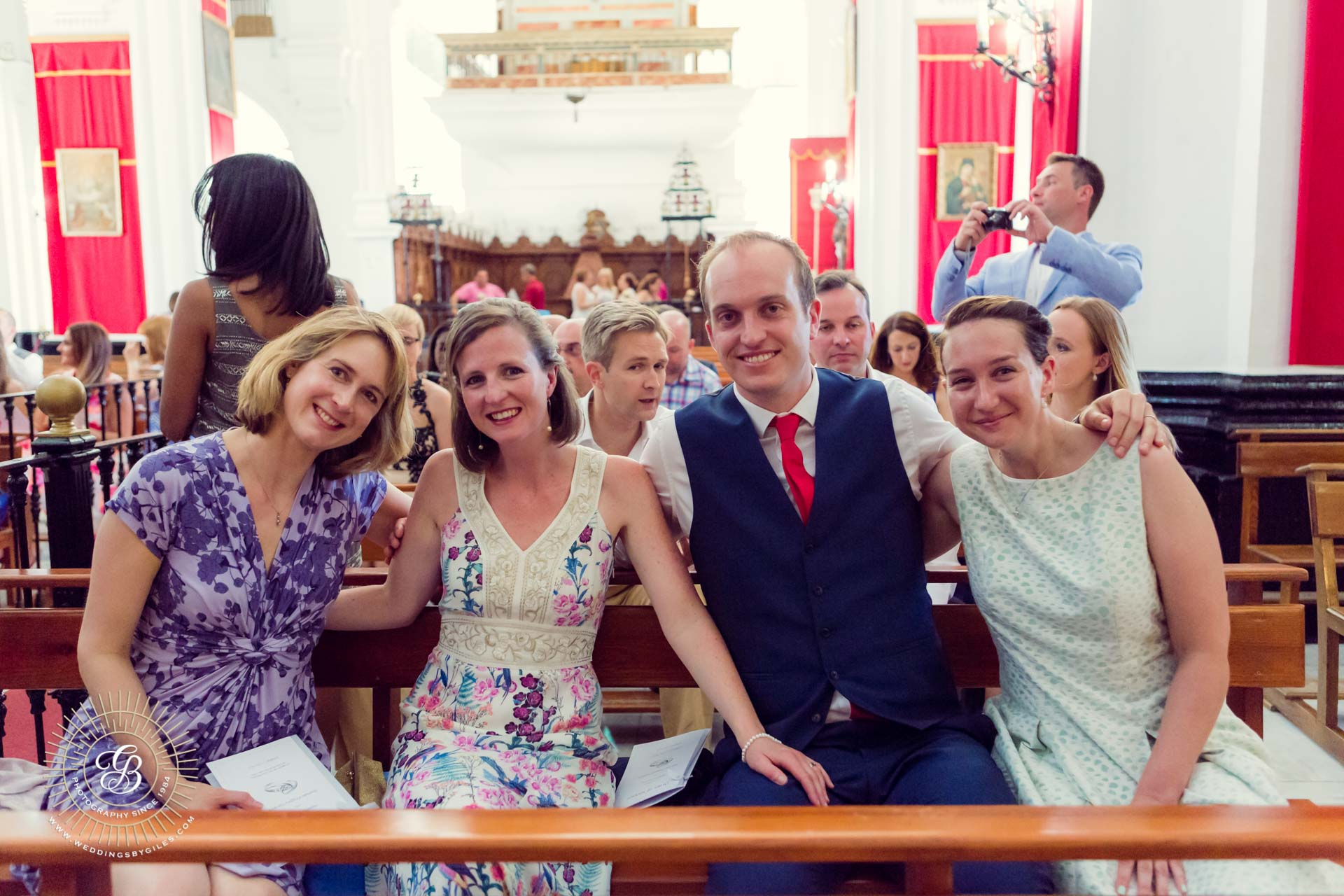 wedding guests wait in church andalucia