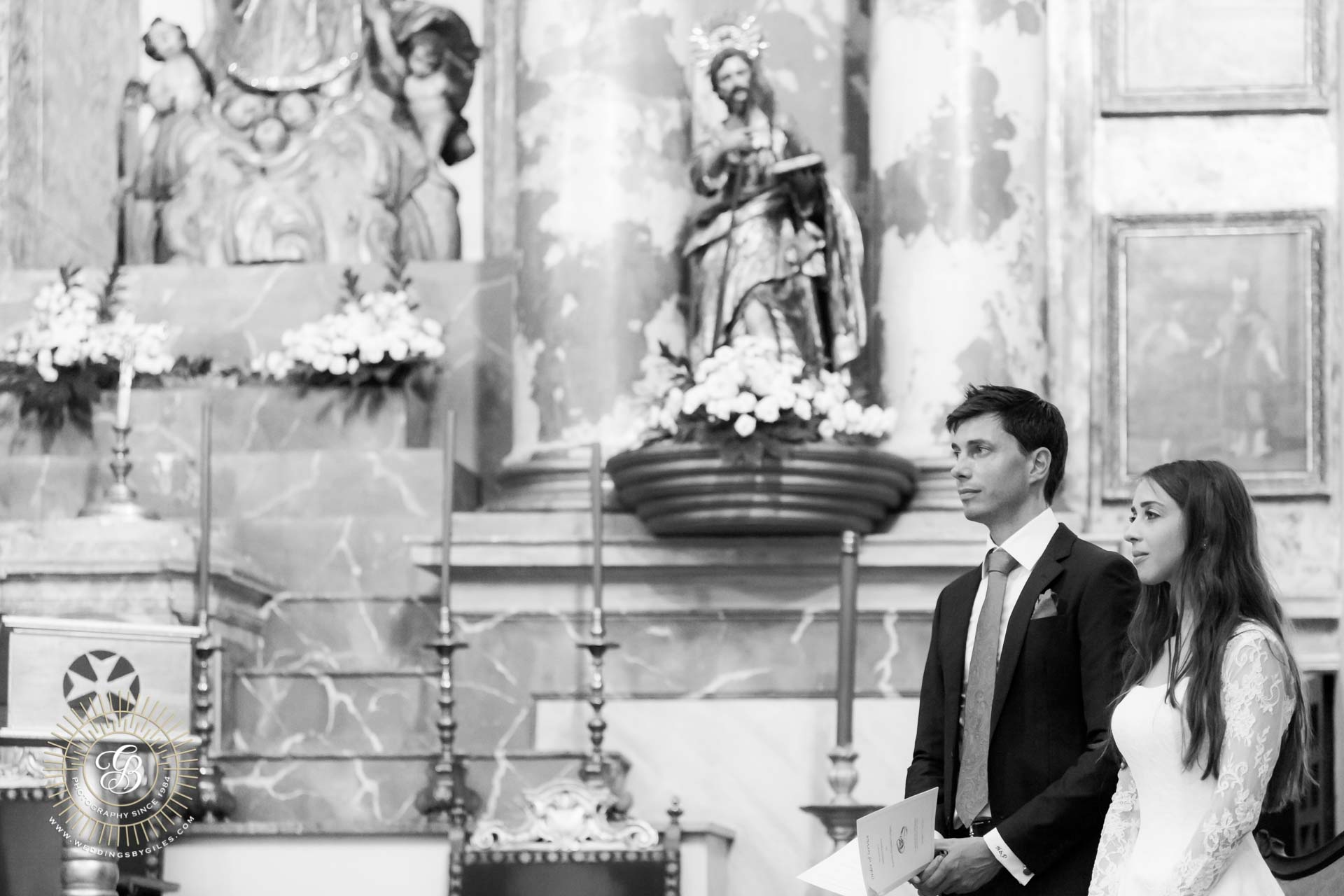 bride and groom in catholic church wedding in spain