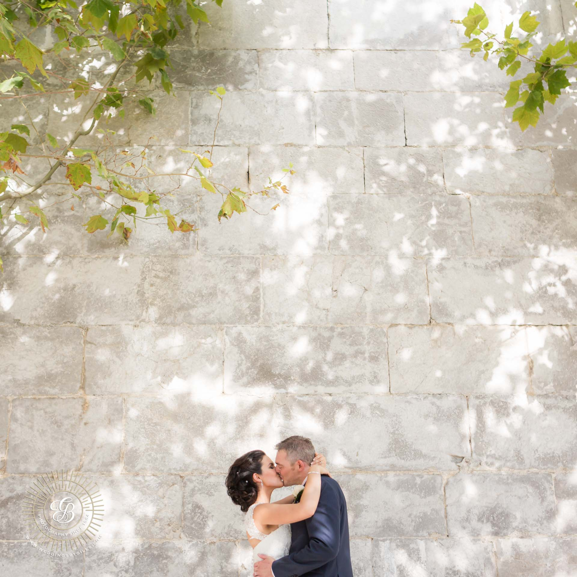 Wedding portrait by town wall