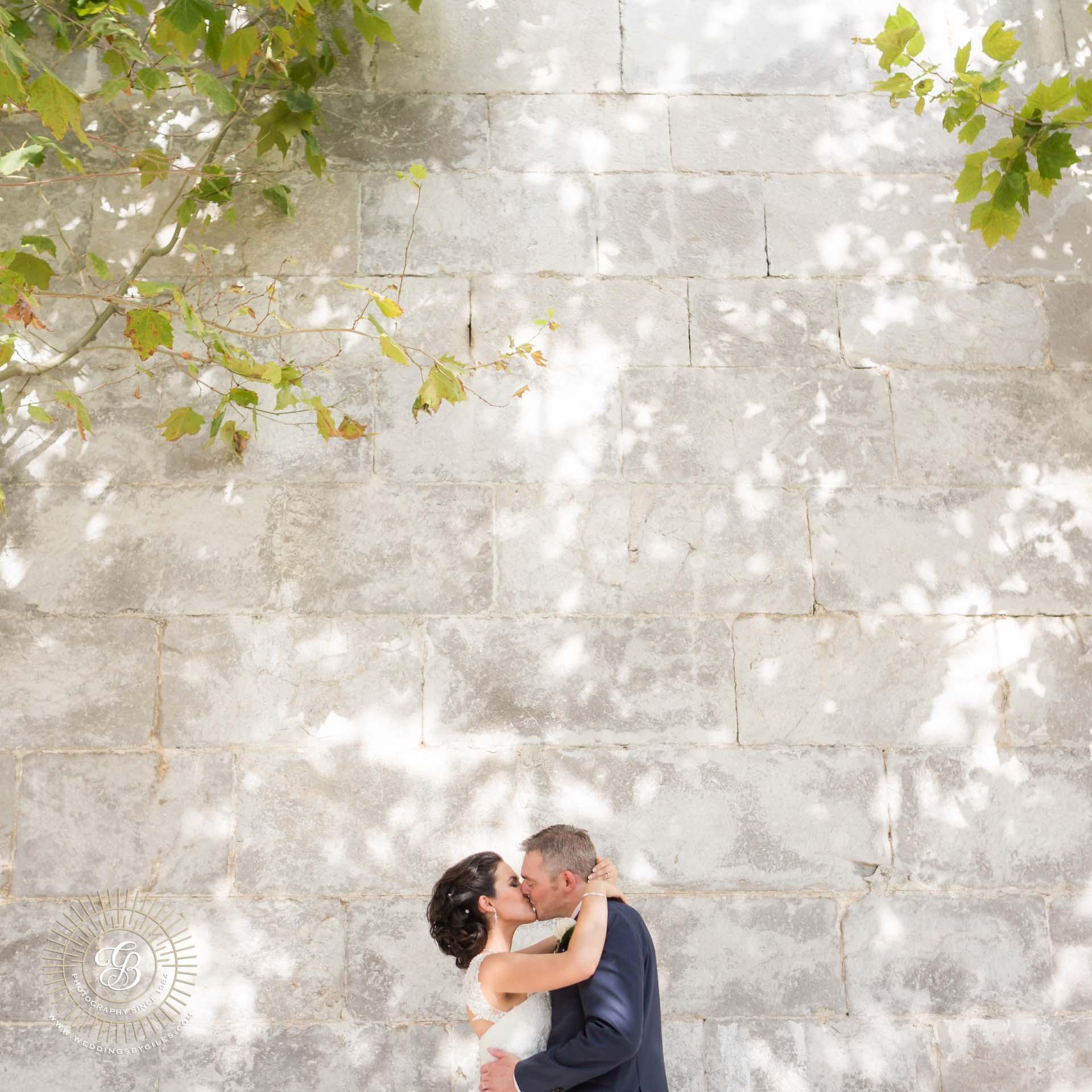 Wedding portrait by town wall