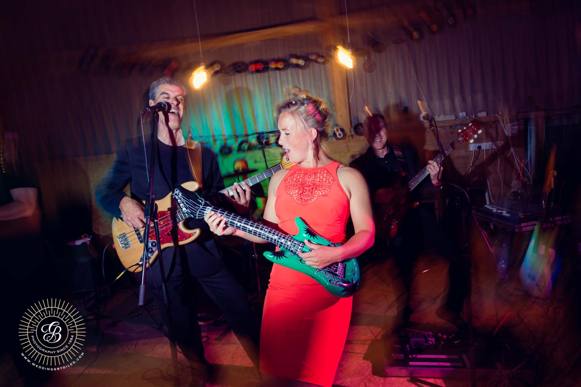 Guest pays with live band at wedding reception