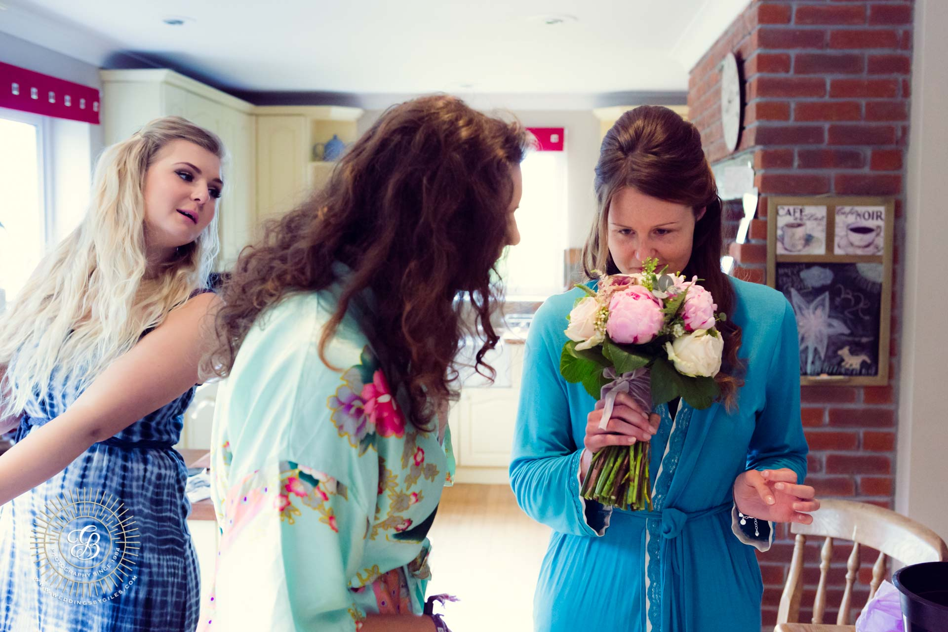 Bride smells her bouquet