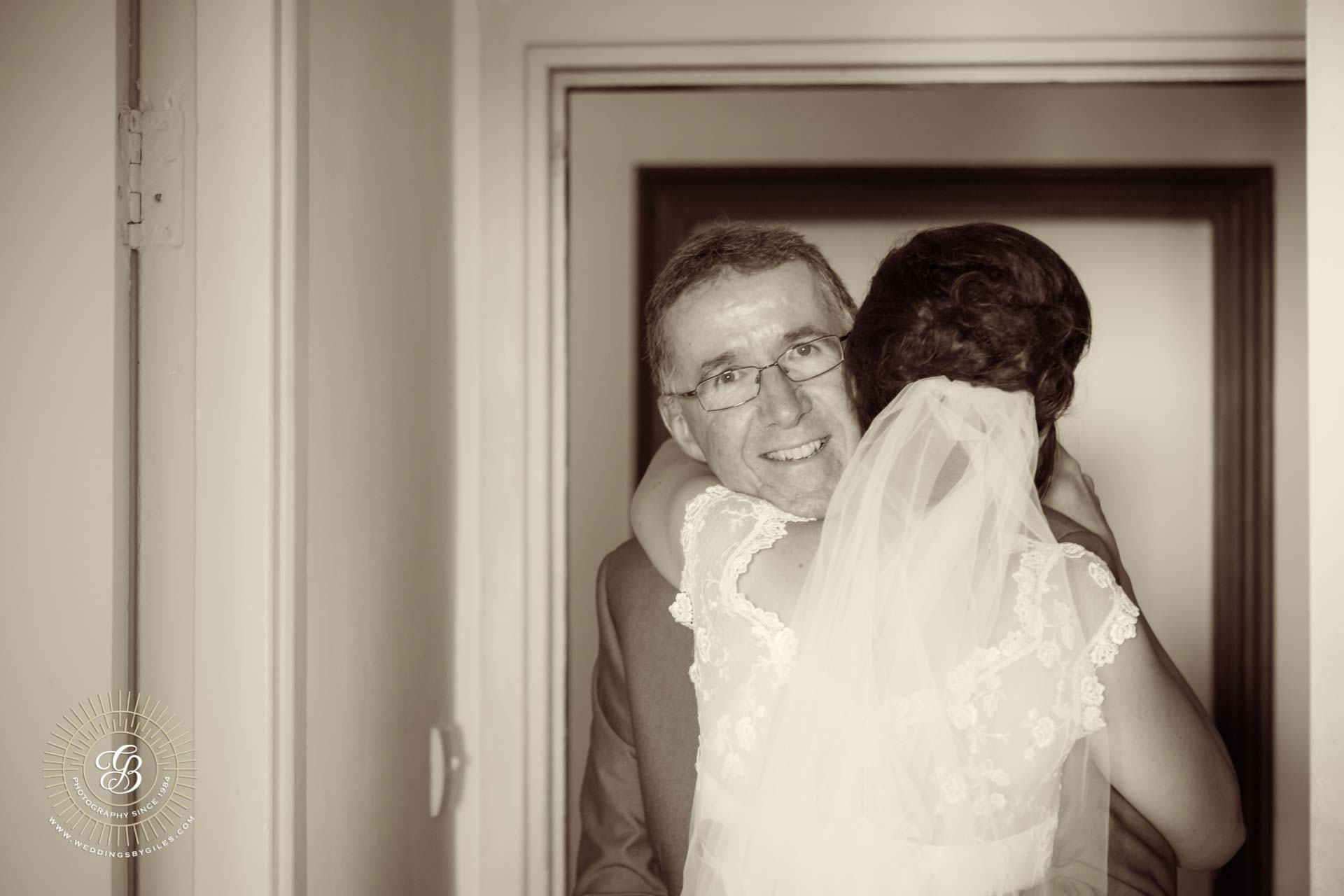 Farther of the bride hugs his daughter