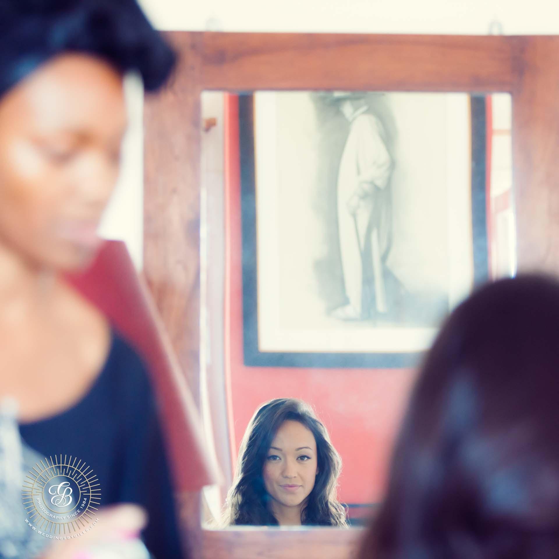 Bride looks in Mirror