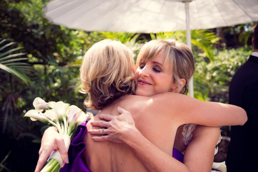 Bride & Bridesmaid embrace