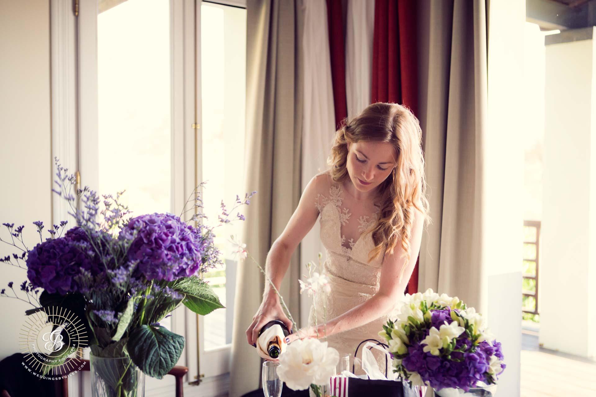 Bride pours champagne
