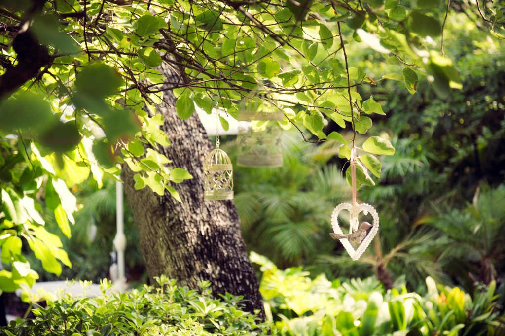 wedding decorations hanging in trees