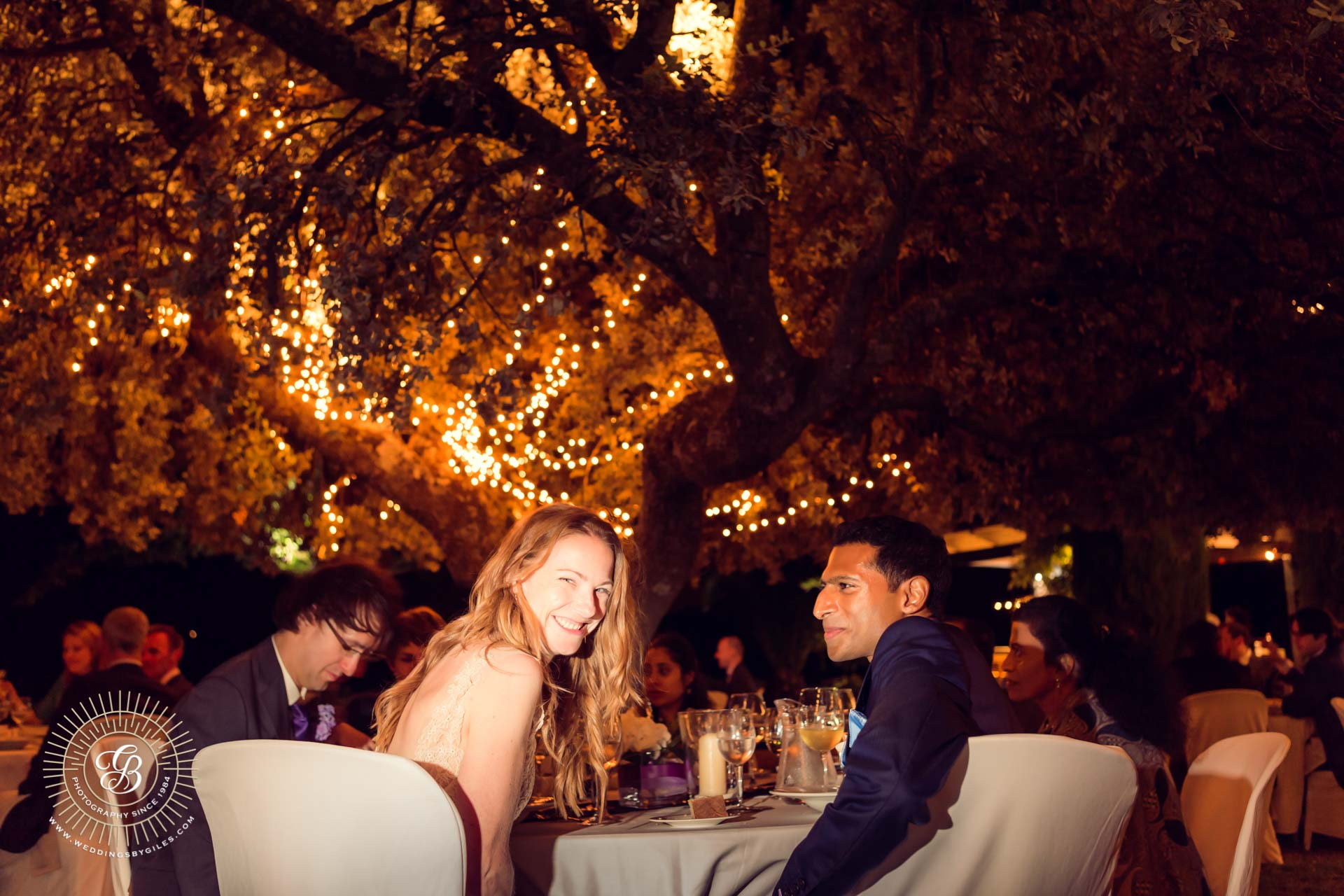 bride and groom portrait at table