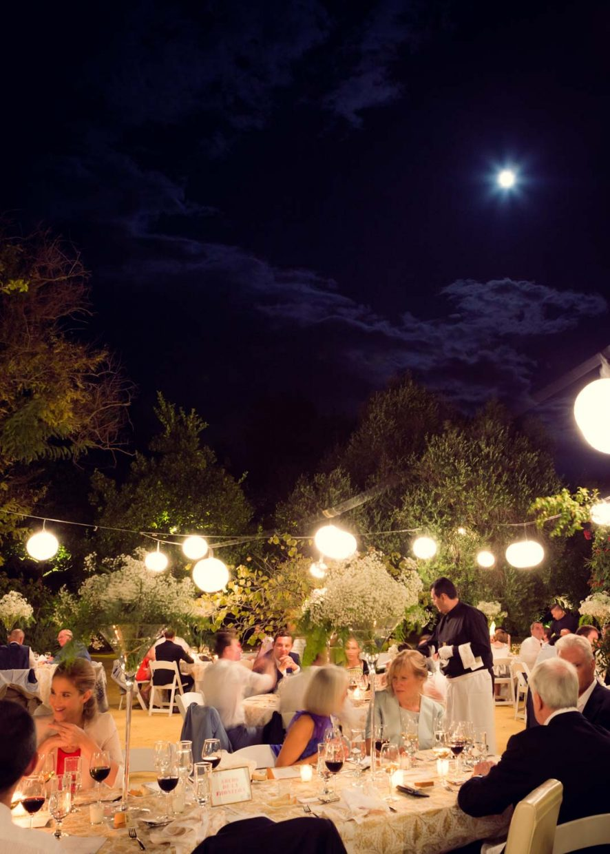 out side at night in spain open air wedding reception at Faín Viejo