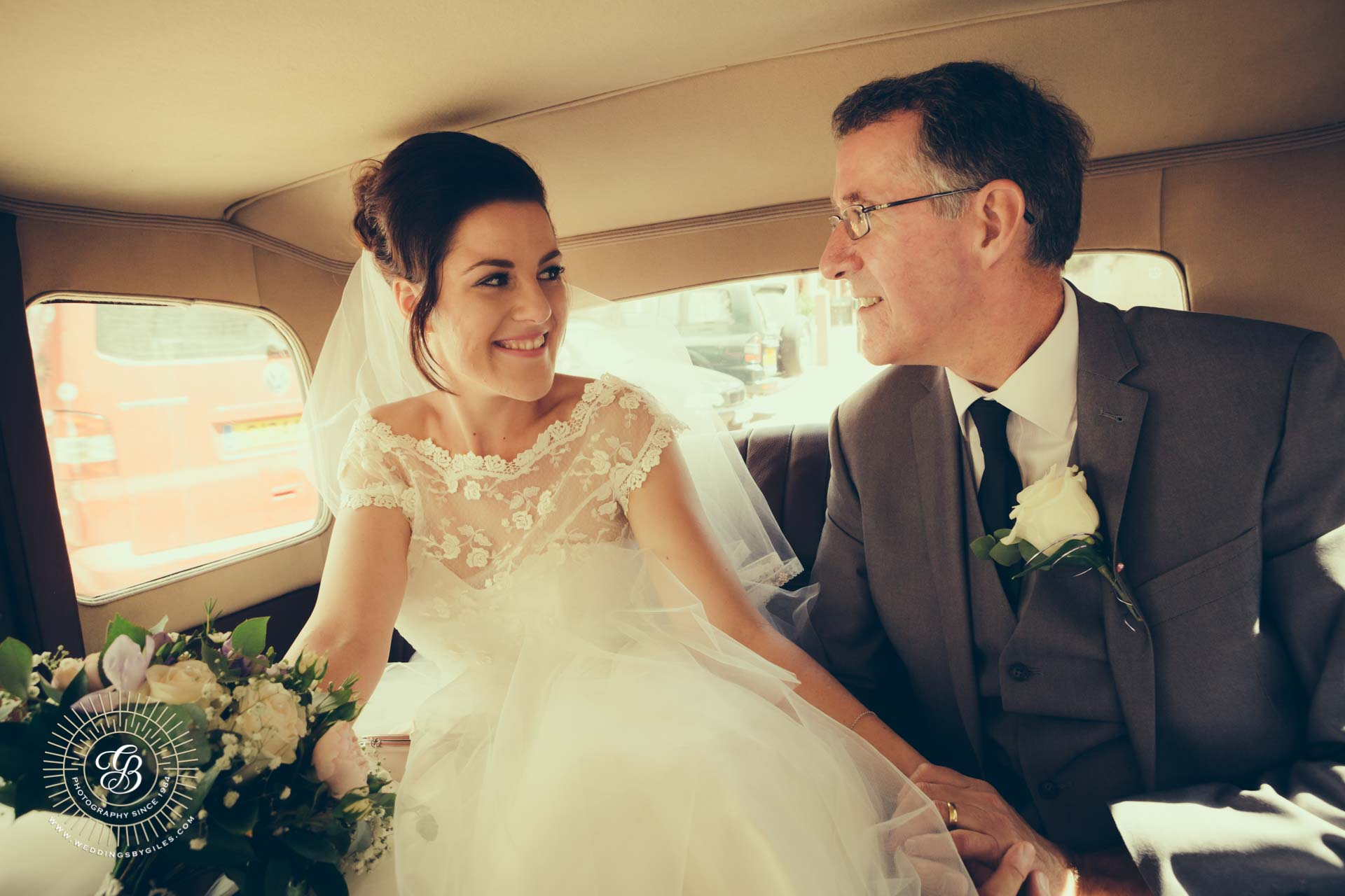 Bride and her father in Vintage wedding car