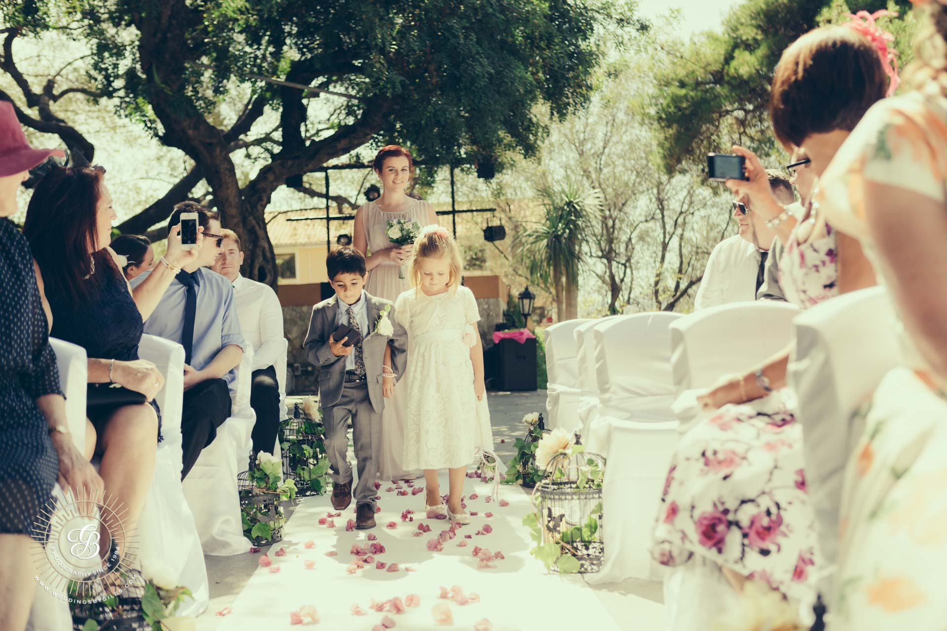 flower girl and page boy down the isle in the Alameda gardens