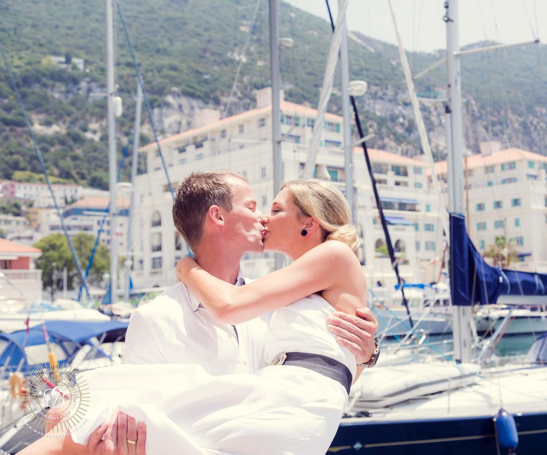 bride and groom kiss at Queensway Quay Marina