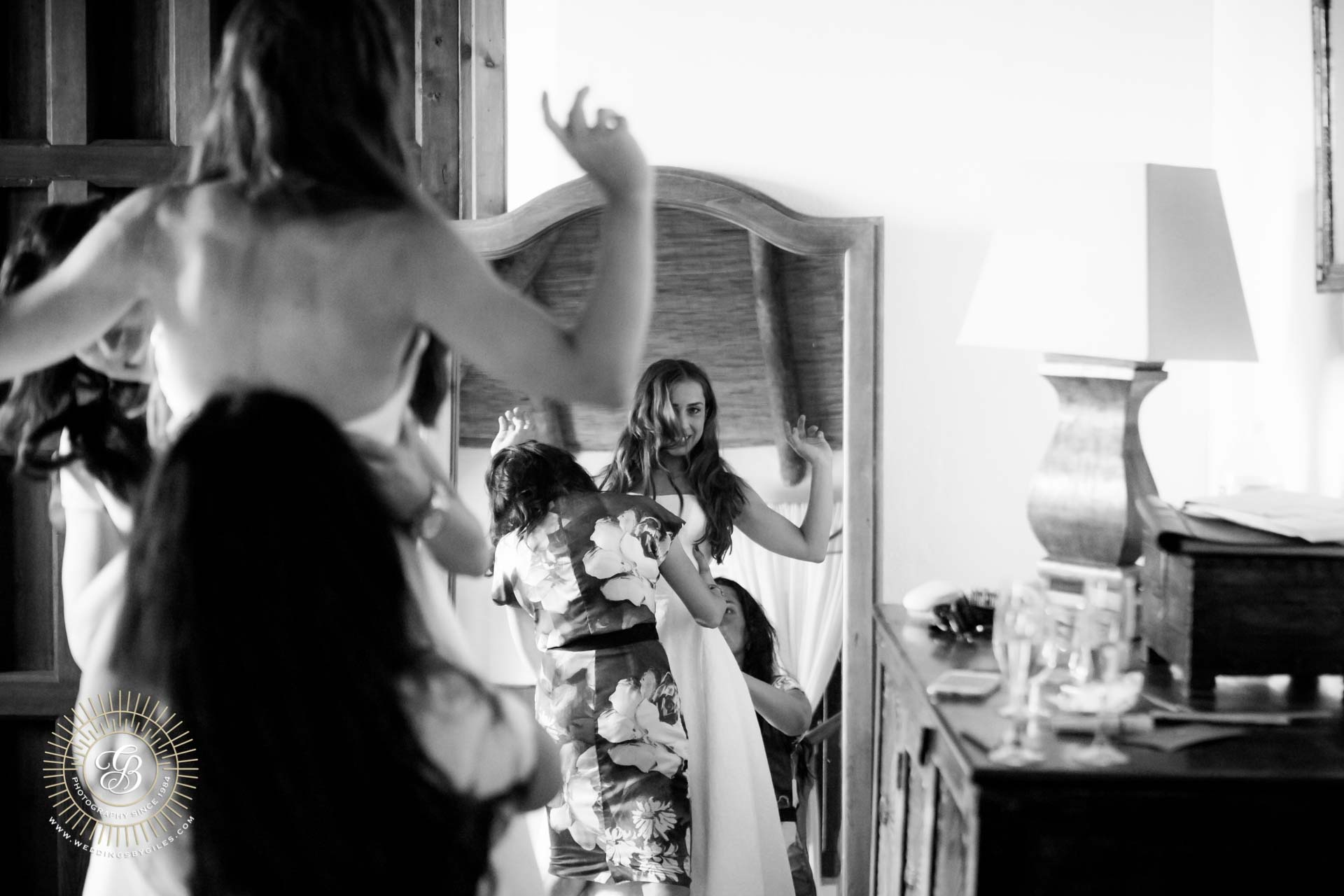 bride getting ready in the mirror