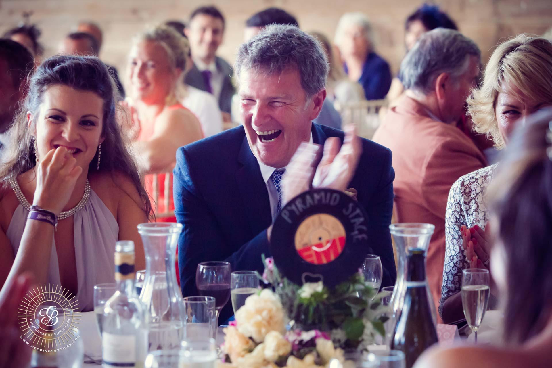 wedding guests laugh at best man's speach