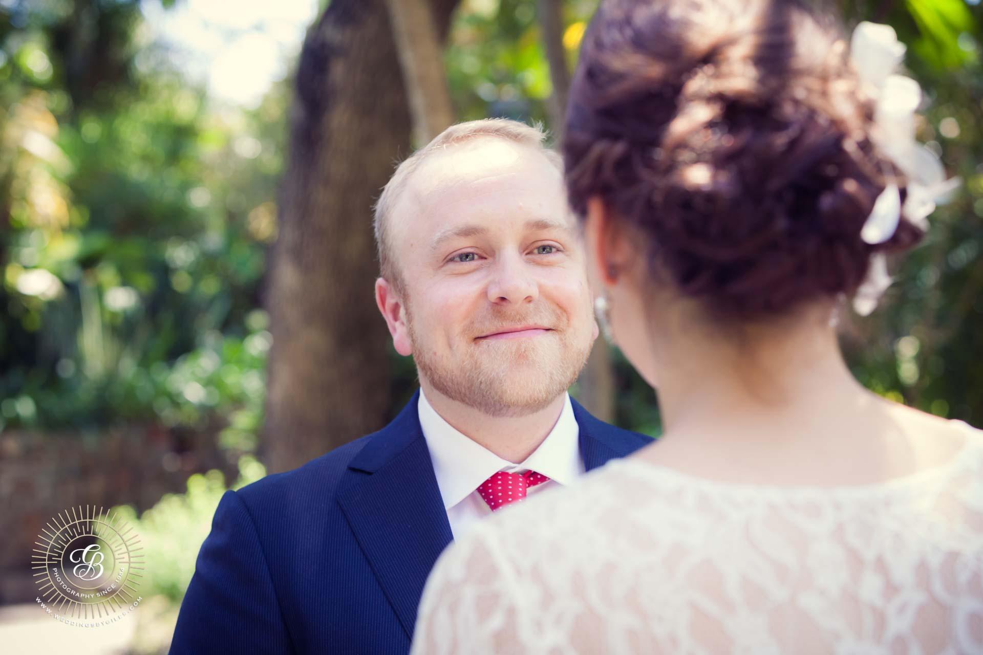 Groom looks at bride