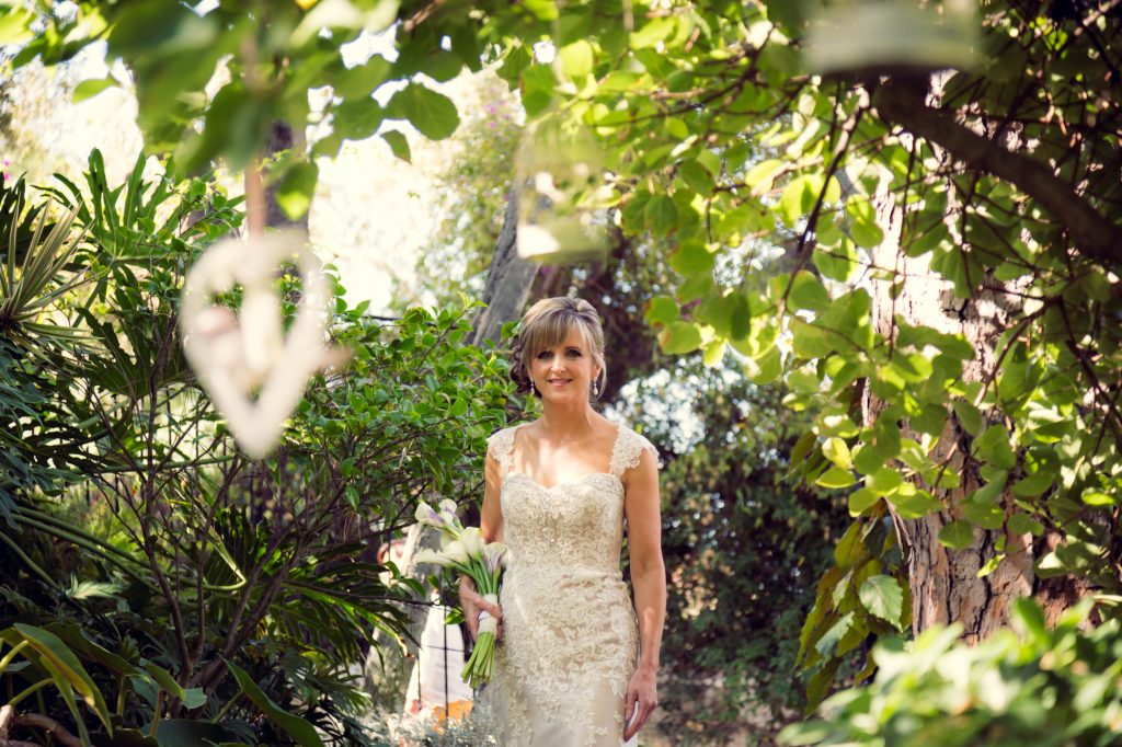 Bride makes entrance into garden wedding wedding ceremony