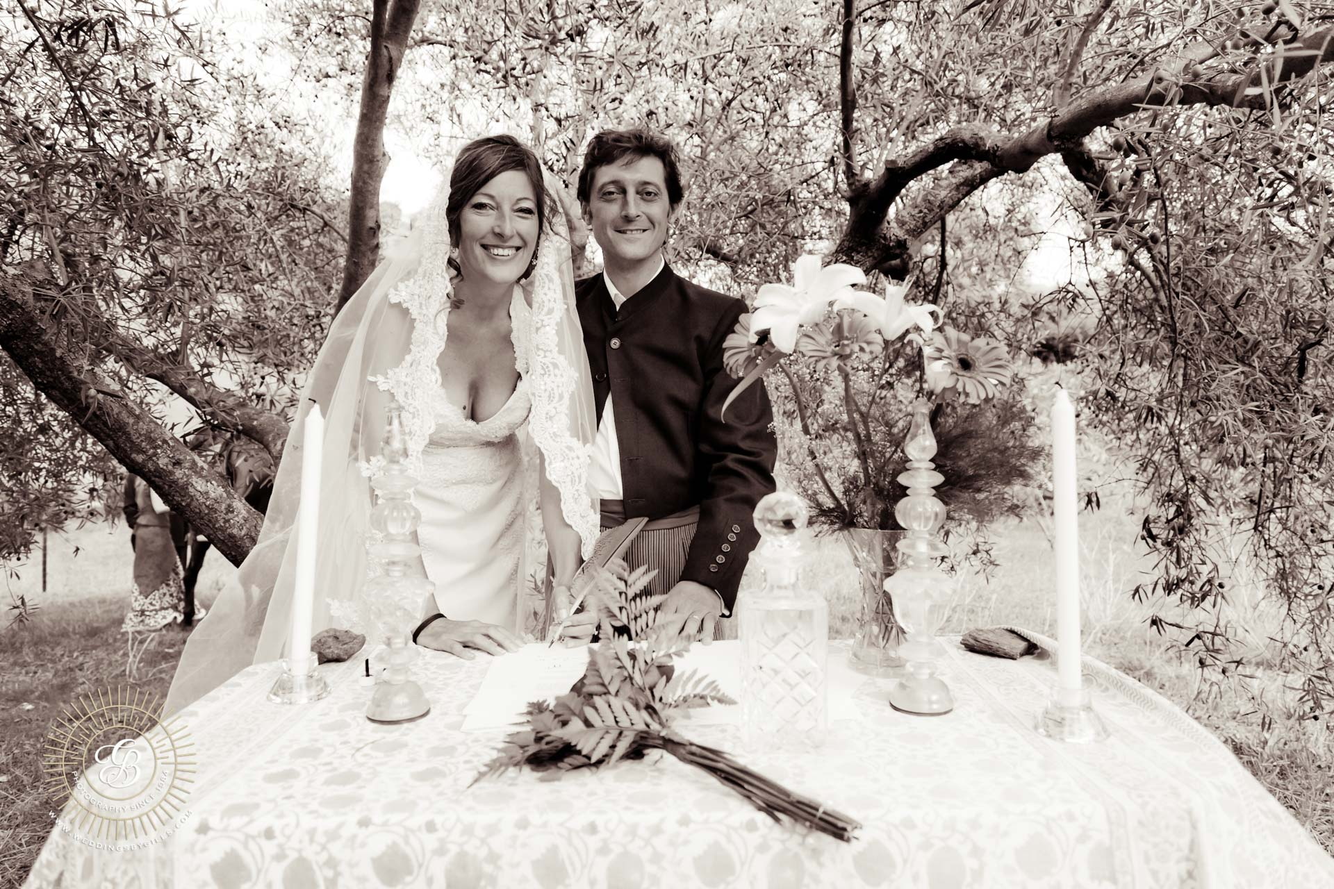 Bride and groom at the altar under the olive tree